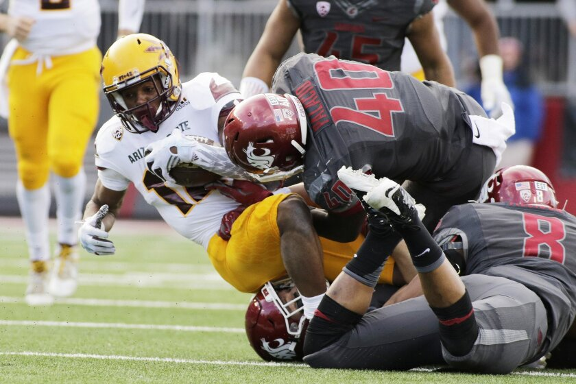 Arizona State wide receiver Tim White (12) is brought down by Washington State linebacker Kache Palacio (40), linebacker Jeremiah Allison (8) and safety Isaac Dotson (31) during the first half of an NCAA college football game, Saturday, Nov. 7, 2015, in Pullman, Wash. (AP Photo/Young Kwak)