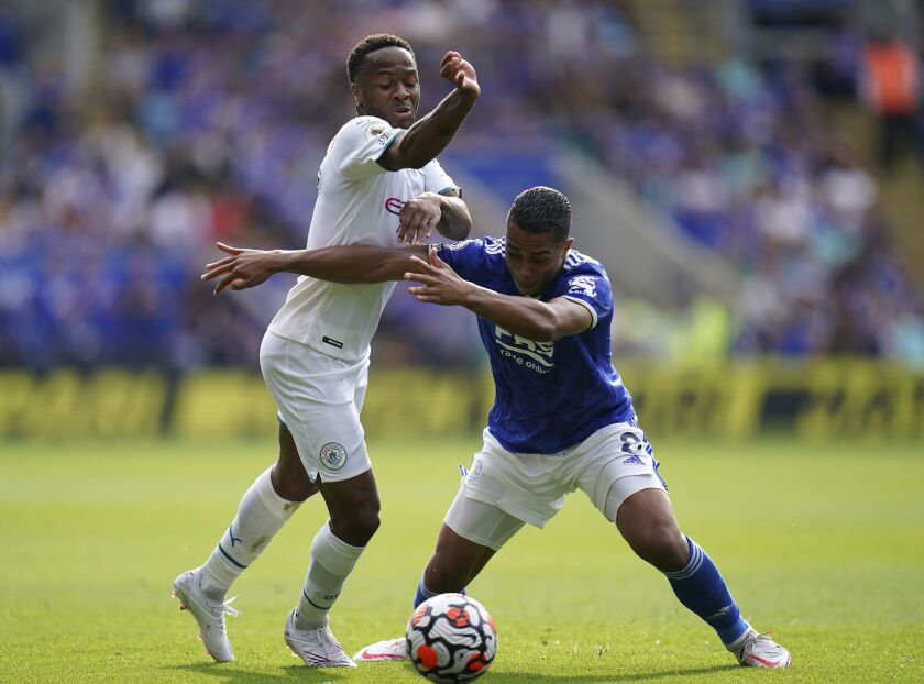 Manchester City's Raheem Sterling, left, and Leicester City's Youri Tielemans battle for the ball during their English Premier League soccer match at The King Power Stadium, Leicester, England, Saturday, Sept. 11, 2021. (Nick Potts/PA via AP)