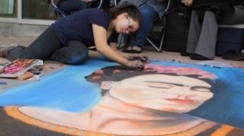 Lidia Vazquez works on her Frida Kahlo painting at a chalk event at Southwestern College