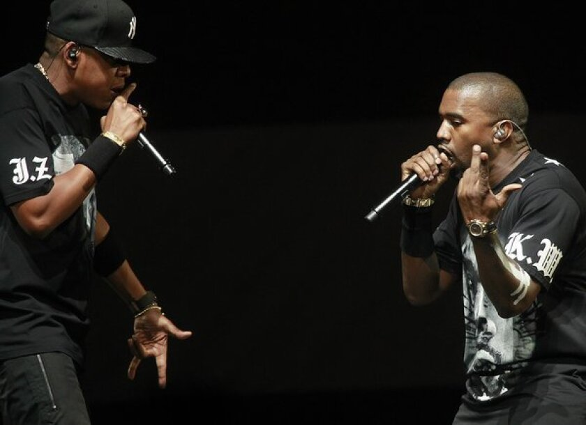 Jay-Z, left, and Kanye West onstage at Staples Center on Dec. 11, 2011, during their Watch the Throne tour stop in Los Angeles.