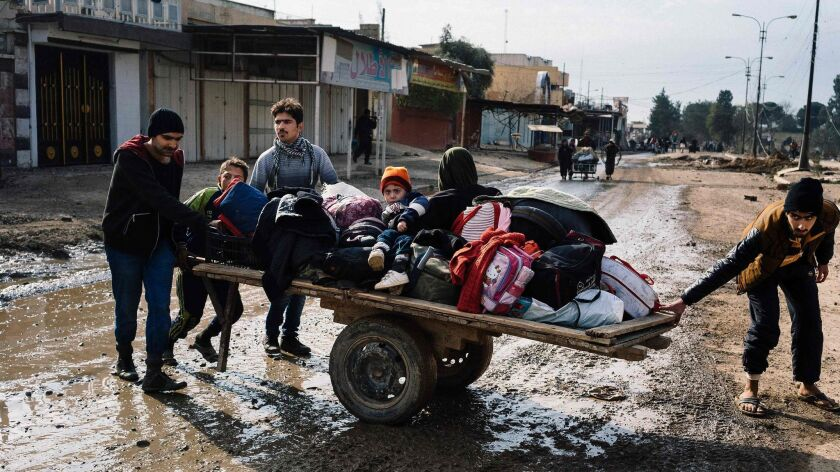 Iraqis move their belongings in Mosul's Zahra neighborhood on Jan. 8, 2017, as they flee with other civilians during military operations against Islamic State.