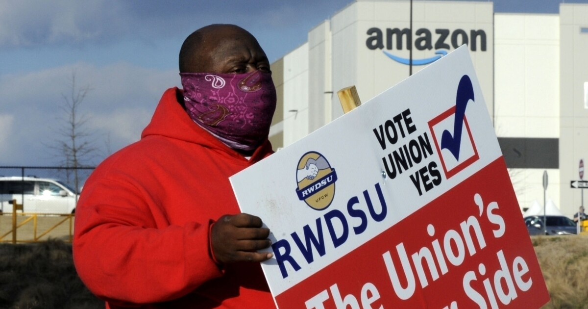 Teamsters vow to unionize Amazon, taking on an anti-union behemoth