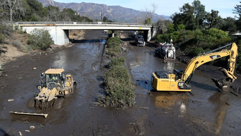 Crews continue cleaning mud from the 101 Freeway in Montecito. (Michael Owen Baker / For The Times)