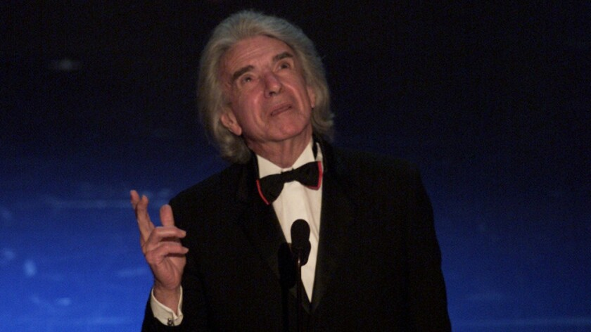 Arthur Hiller, former president of the Academy of Motion Picture Arts and Sciences, speaks after accepting the Jean Hersholt Humanitarian Award during the 74th Academy Awards in 2002.