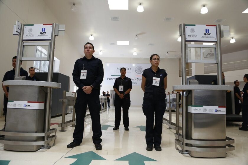 Mexican customs inspectors at the inauguration of Mexico's new pedestrian entry on Tijuana's border with San Ysidro.