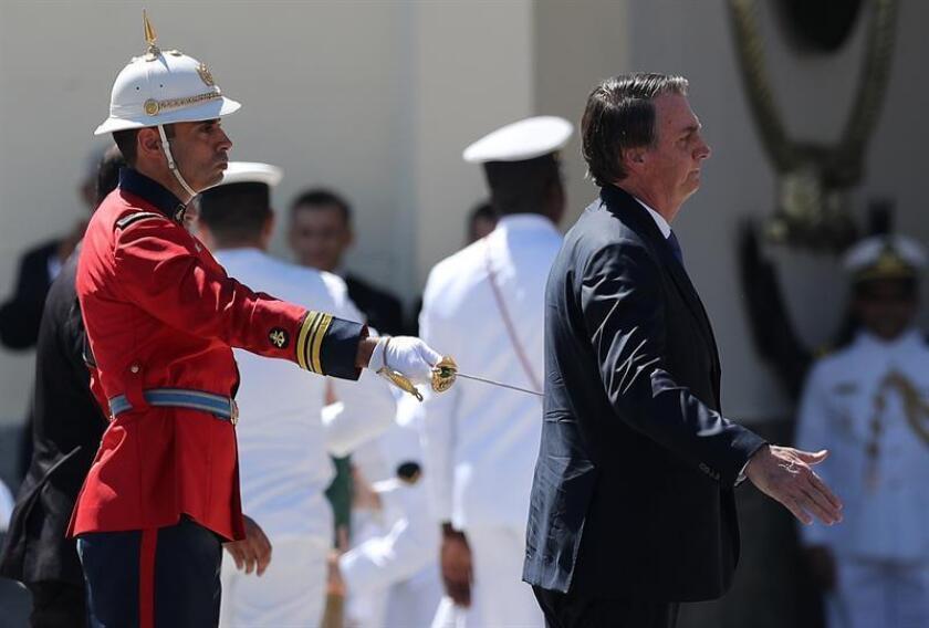 Brazilian President Jair Bolsonaro participate on March 7, 2019, at the Rio de Janeiro naval base in a military ceremony, where he discussed pension reform. EFE-EPA / ANTONIO LACERDA