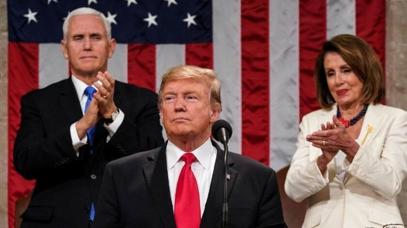 President Trump delivers his State of the Union address, flanked by Vice President Mike Pence and House Speaker Nancy Pelosi, on Feb. 5.