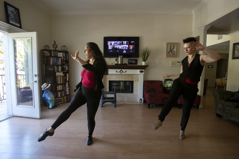 Dance instructor Arlene Santos, left, with student Amy Rubinstein.