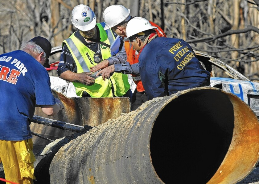 In 2010, inspectors from the U.S. Department of Transportation and the Public Utilities Commission listen to an inspector from Pacific Gas & Electric as they investigate a deadly natural gas pipeline explosion in San Bruno.