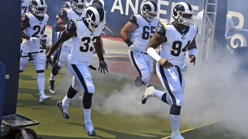 Los Angeles Rams running back Justin Davis (33) and defensive lineman John Franklin-Myers (94) head