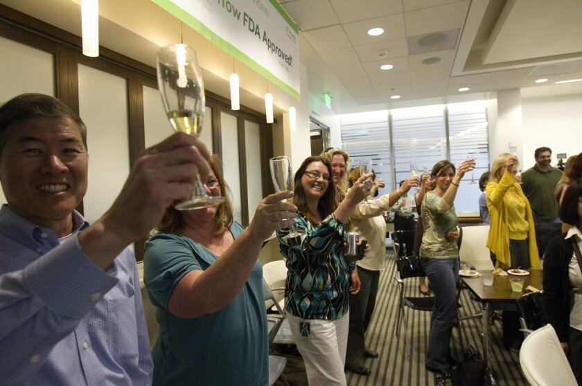 Optimer Pharmaceuticals employees on celebrated the Food and Drug Administration's approval of the San Diego company's first commercial drug, Dificid.