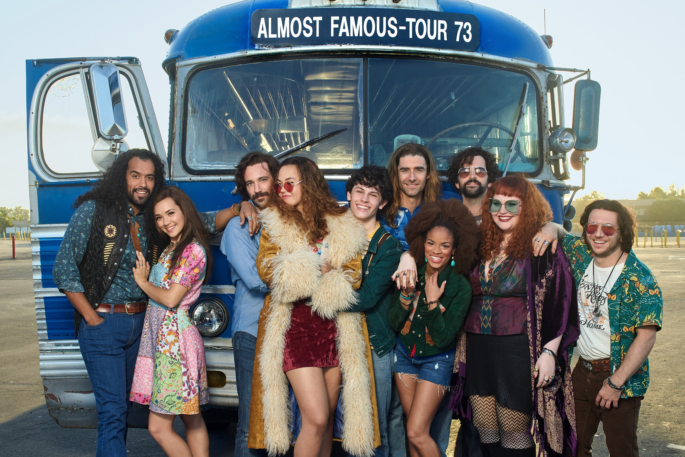 """Members of the cast of """"Almost Famous,"""" from left: Brandon Contreras as Silent Ed Vallencourt, Julia Cassandra as Estrella, Colin Donnell as Russell Hammond, Solea Pfeiffer as Penny Lane, Casey Likes as William Miller, Drew Gehling as Jeff Bebe, Storm Lever as Polexia, Matt Bittner as Larry Fellows, Katie Ladner as Sapphire, and Gerard Canonico as Dick Roswell; from Almost Famous, a world-premiere musical with book and lyrics by Cameron Crowe, based on his iconic film; directed by Jeremy Herrin, with original music and lyrics by Tom Kitt; runs September 13 – October 27, 2019 at The Old Globe."""