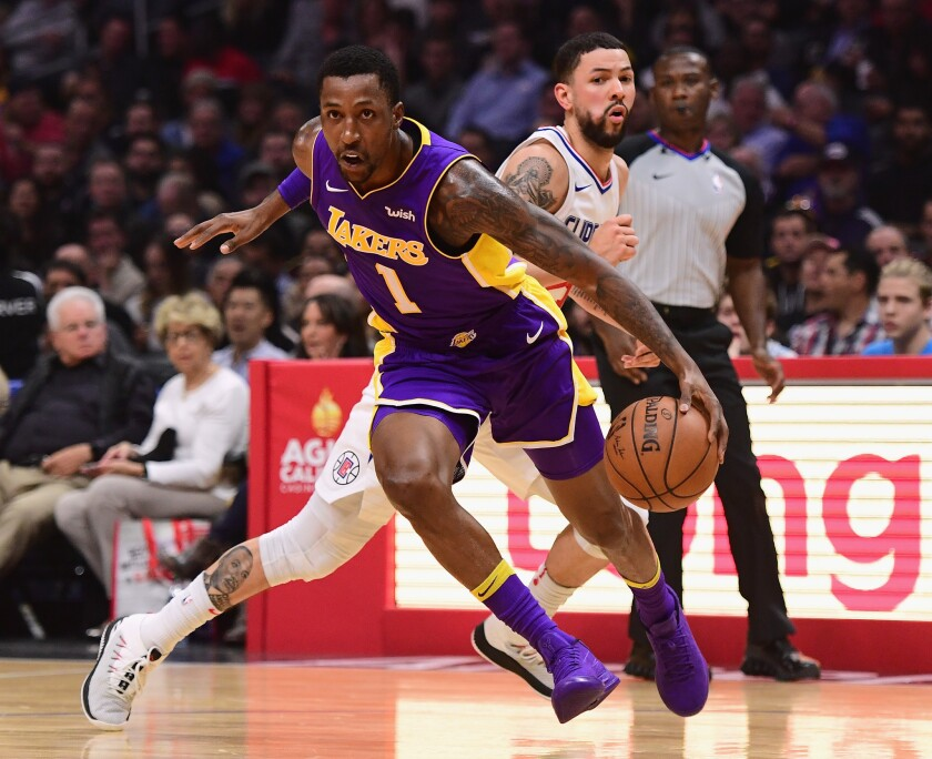 LOS ANGELES, CA - NOVEMBER 27: Kentavious Caldwell-Pope #1 of the Los Angeles Lakers drives to the basket past Austin Rivers #25 of the LA Clippers during the first quarter in a 120-115 LA Clipper win at Staples Center on November 27, 2017 in Los Angeles, California.