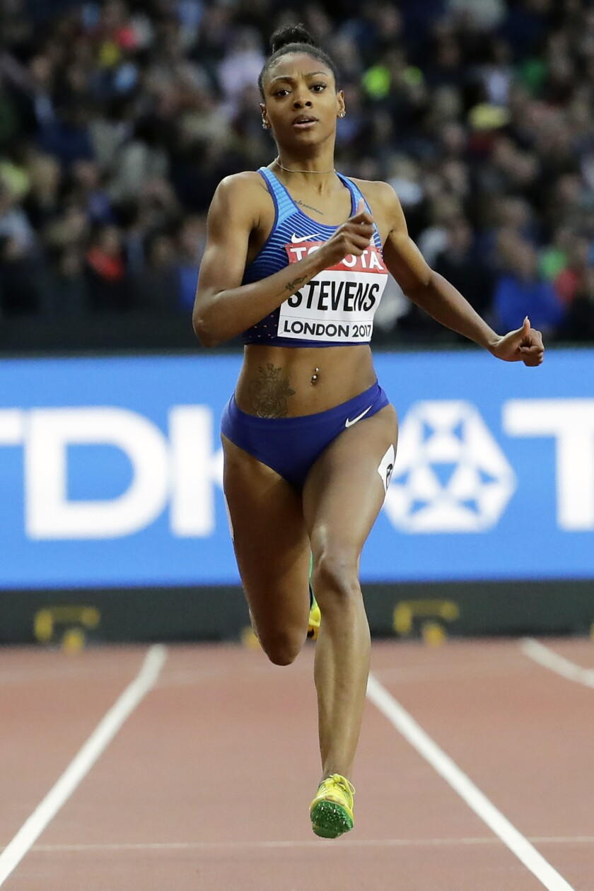 FILE - In this Aug. 8, 2017, file photo, United States' Deajah Stevens races in a women's 200m first round heat during the World Athletics Championships in London. American sprinter Deajah Stevens was provisionally suspended Friday, May 1, 2020, for repeatedly being unavailable for doping tests.The Athletics Integrity Unit said Stevens amassed three whereabouts violations in a year. (AP Photo/David J. Phillip, File)