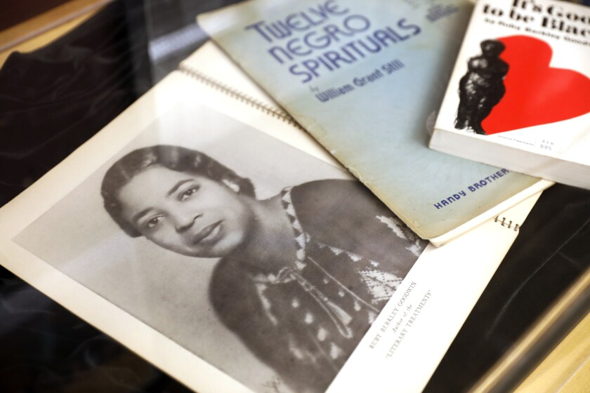 A song book, with a photo of curator Leah Goodwin's grandmother on the cover, part of an exhibit at the Women's Museum of California in Liberty Station.