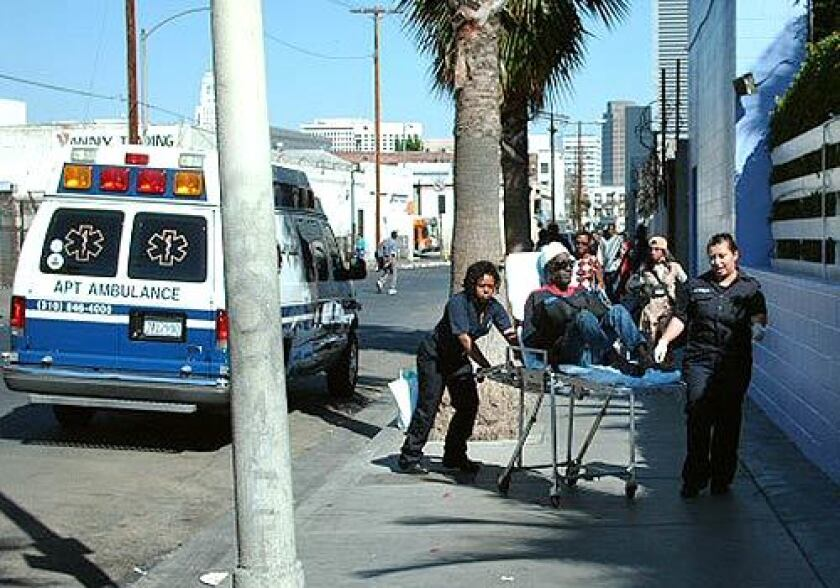 ON SKID ROW: A police videotape shows Johny Williams being taken from an ambulance to the Volunteers of America homeless center in downtown L.A. Williams, one of five patients from Los Angeles Metropolitan Medical Center who were videotaped by police Sunday being dropped off on skid row, told officers he had wanted to go to Pasadena.