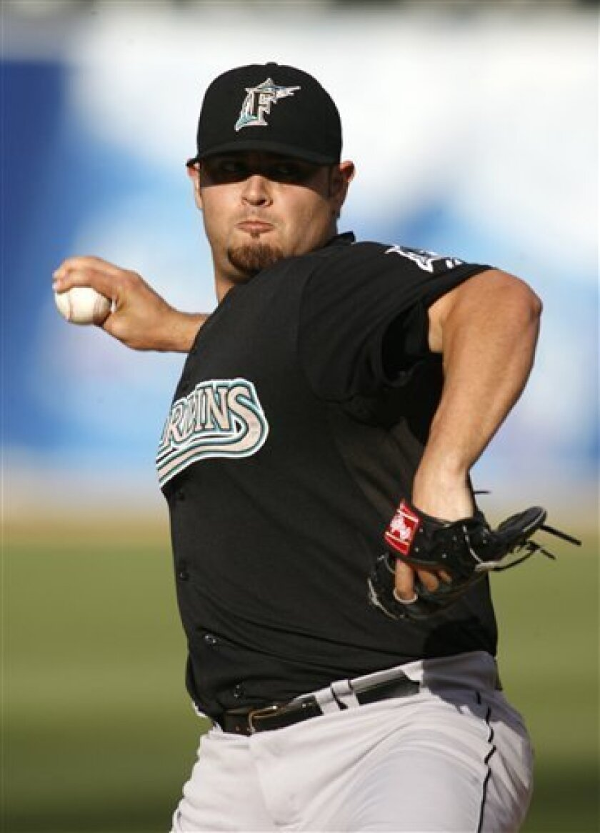 Florida Marlins pitcher Ricky Nolasco delivers against the Oakland Athletics in the first inning of a baseball game, Saturday, June 21, 2008, in Oakland, Calif. (AP Photo/D. Ross Cameron)