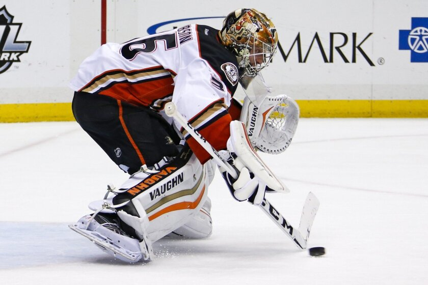 A shot by Pittsburgh Penguins' Sidney Crosby gets past the stick of Anaheim Ducks goalie John Gibson (36) for a goal during the second period of an NHL hockey game in Pittsburgh, Monday, Feb. 8, 2016. (AP Photo/Gene J. Puskar)