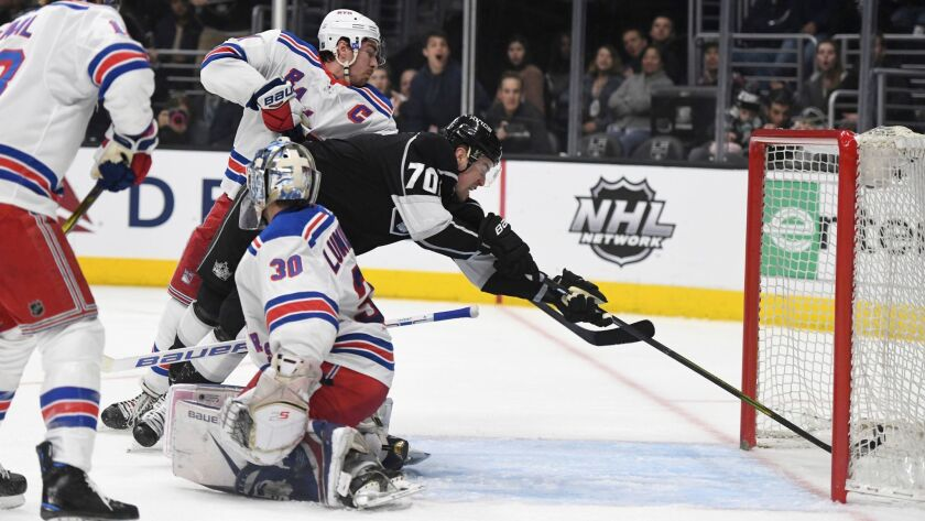 Los Angeles Kings left wing Tanner Pearson (70) scores behind New York Rangers goalie Henrik Lundqvist during the second period.
