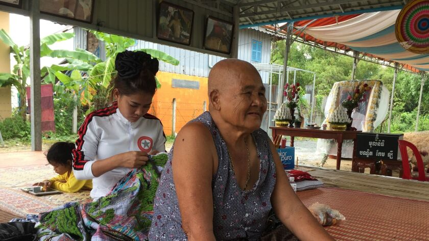Pok Sin, Kem Ley's 78-year-old mother, sits at the family's home in Takeo province receiving a steady stream of mourners.