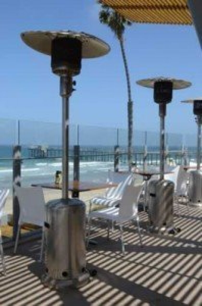 Patrons can see the Scripps Pier from Caroline's terrace.