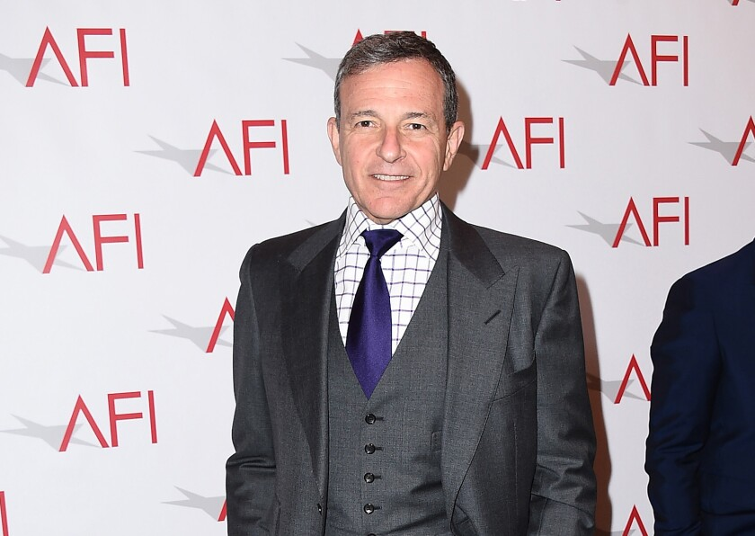 In this Jan. 9, 2015 file photo, Walt Disney Co. Chairman and Chief Executive Officer Bob Iger arrives at the AFI Awards at The Four Seasons Hotel in Los Angeles. Iger's pay dropped 3 percent in 2015 - to $44.9 million.