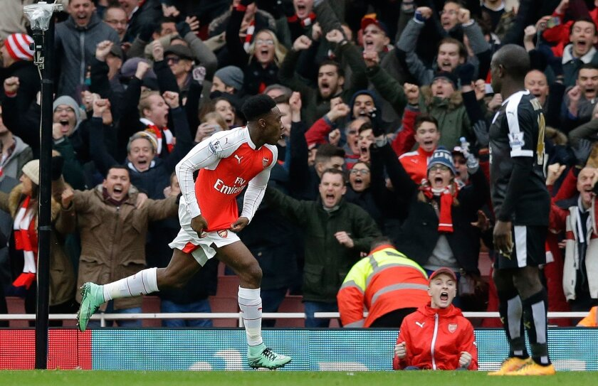 Arsenal's  Danny Welbeck celebrates after scoring his side's second goal during the English Premier League soccer match between Arsenal and Leicester City at the Emirates Stadium in London, Sunday, Feb. 14, 2016.  (AP Photo/Matt Dunham)