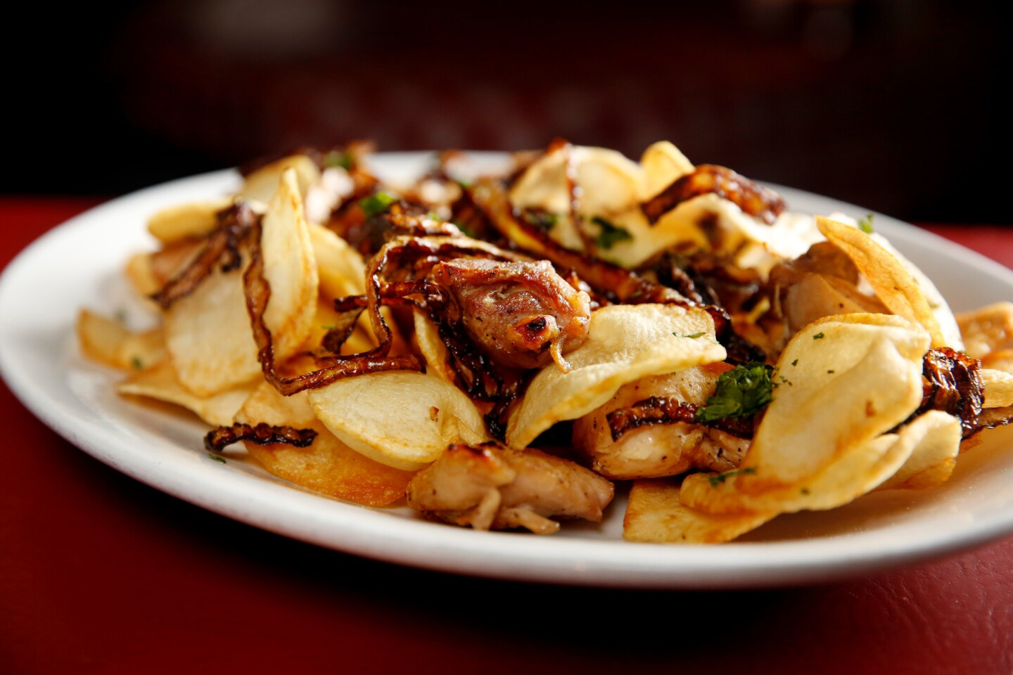 A lot of the dishes at Dan Tana's are named after people. The late Hollywood producer Sidney Beckerman's moniker is attached to this assemblage of freshly made potato chips, tender onions and garlic, as well as to a version in which all of this accompanies baked dark-meat chicken.
