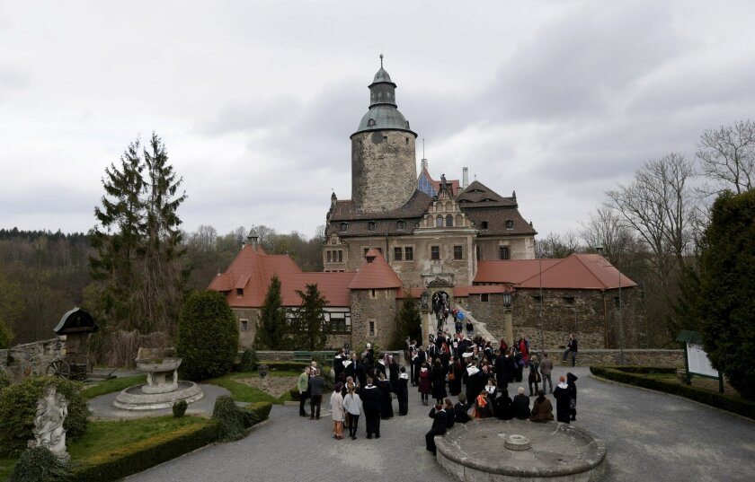 In this picture taken on Thursday, April 16, 2015, participants gather to receive instructions prior to their Harry Potter inspired role playing game at the Czocha Castle, in Sucha, southwestern Poland. Some 140 enthusiasts coming from 50 countries and places as far-away as the United States will l