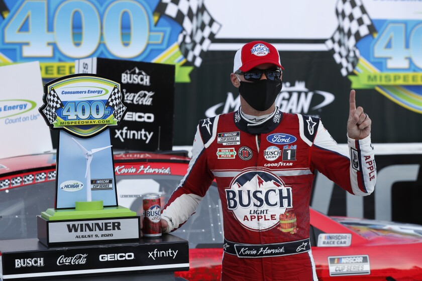 Kevin Harvick celebrates after winning Sunday's NASCAR Cup race at Michigan International Speedway.