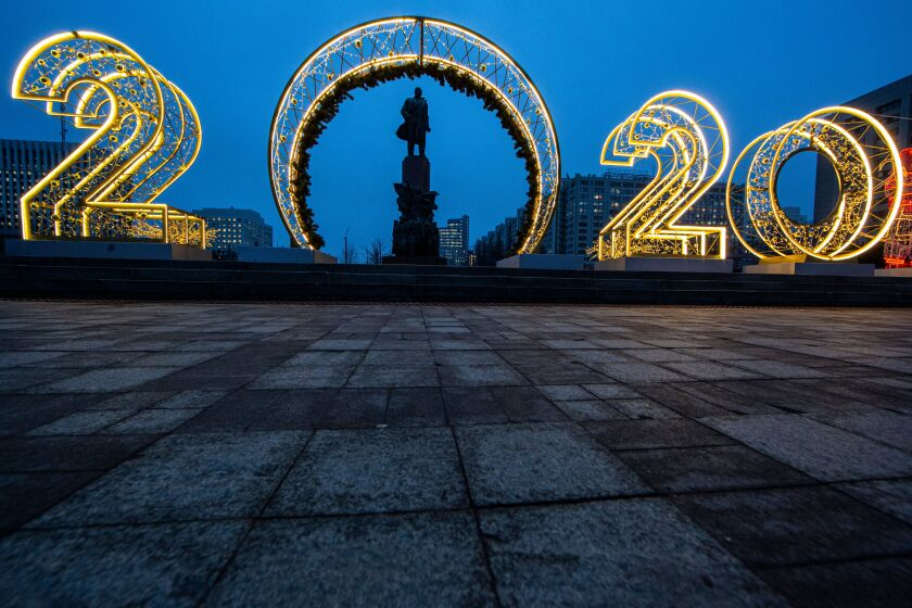 New Year's decorations surround the monument to Lenin in Moscow.