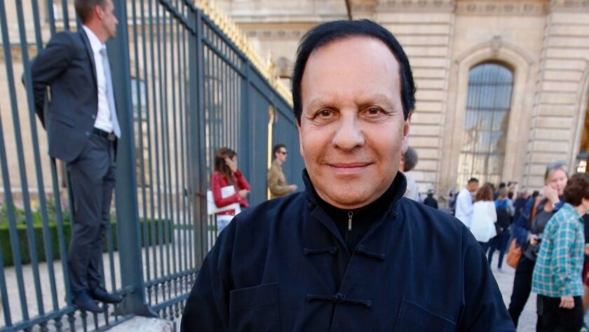 Tunisian-born fashion designer Azzedine Alaia arrives at a fashion event in Paris, on Sept. 26, 2014. The French Haute Couture Federation announced Alaia's death on Nov. 18, 2017. He was 77.