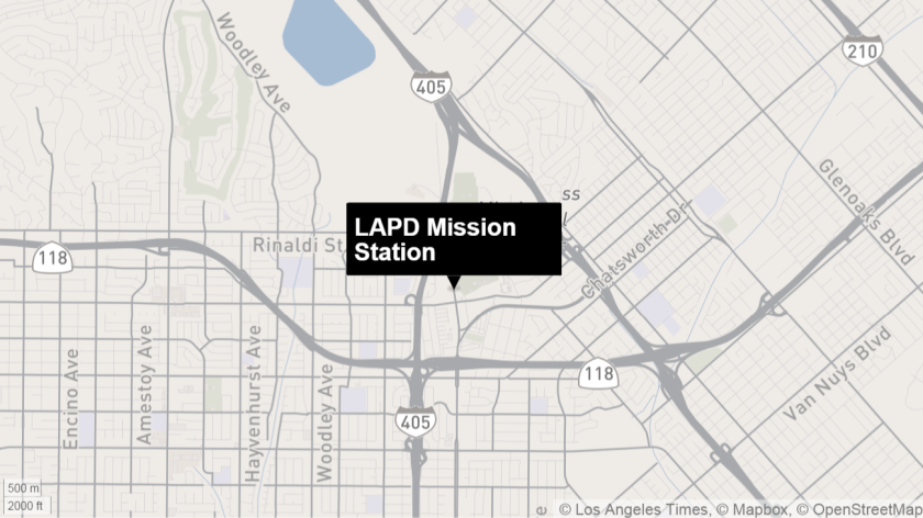 A woman carried a grenade Sunday into the LAPD's Mission Station, prompting an evacuation of the station that lasted more than two hours.