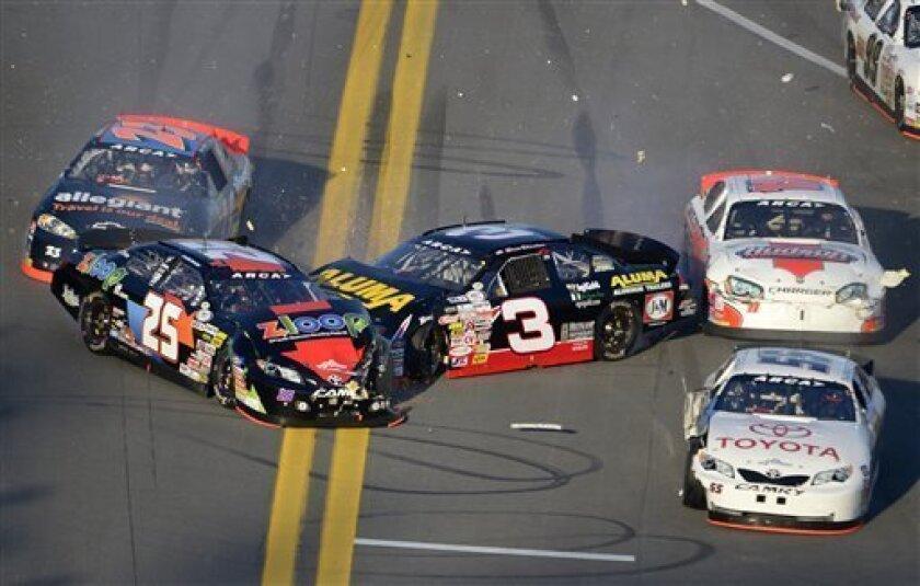 Justin Boston (25), Spencer Gallagher (23), Drew Charlson (3), Brett Hudson (11) and Darrell Wallace (55) collide during the ARCA Series auto race at Daytona International Speedway in Daytona Beach, Fla., Saturday, Feb. 16, 2013. (AP Photo/Phelan M. Ebenhack)