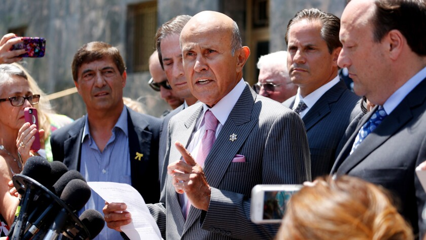 Former Los Angeles County Sheriff Lee Baca makes a statement announcing the withdrawal of his guilty plea.