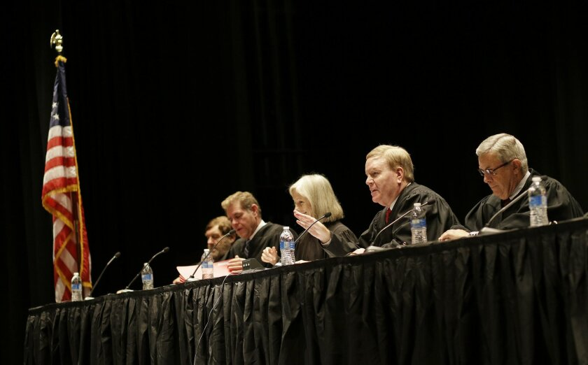 In this Oct. 8, 2014, photo, the Supreme Court of Nevada prepares to hear oral arguments at Palo Verde High School in Las Vegas. Justice hasn't always been swift in Nevada, which until last week's election was one of 10 states in the nation without an intermediate court of appeals. (AP Photo/John Locher)