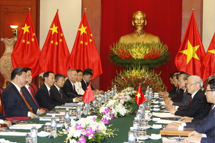 Chinese President Xi Jinping, left, and Vietnamese Communist Party General Secretary Nguyen Phu Trong, second right, attend a meeting at the Central Communist Party headquarters in Hanoi, Vietnam, Thursday, Nov. 5, 2015. Xi's meetings in Vietnam beginning Thursday follow the communist countries' ef