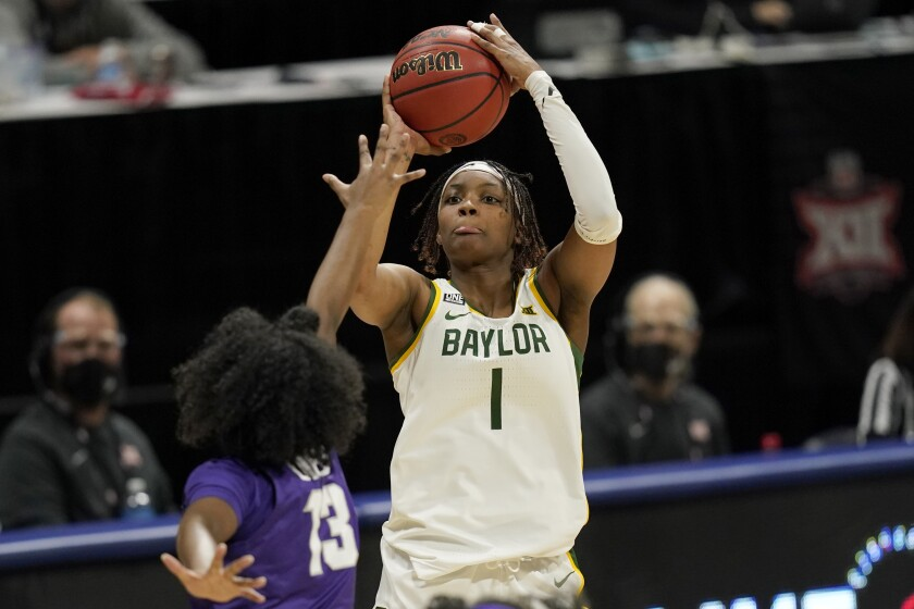 Baylor forward NaLyssa Smith (1) shoots over TCU guard Tavy Diggs (13) during the first half of an NCAA college basketball game in the quarterfinal round of the Big 12 Conference tournament in Kansas City, Mo., Friday, March 12, 2021. (AP Photo/Orlin Wagner)