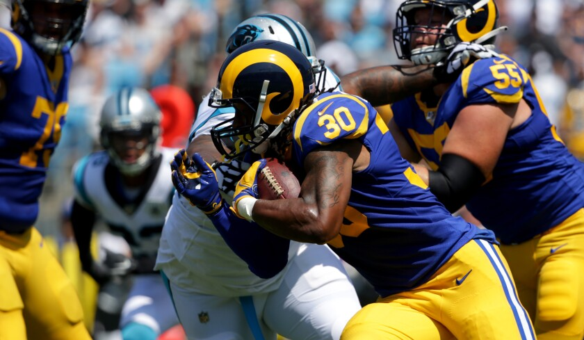 Todd Gurley of the Rams attacks the Carolina defense during one of his 14 carries. Despite rushing only five times for eight yards in the first half, Gurley finished with 97 yards for a 6.92 average.