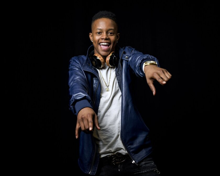 """In this July 21, 2015 photo, 17-year-old rapper Silento poses for a portrait in New York. Silento's song, """"Watch Me (Whip/Nae Nae),"""" has sold 892,168 tracks and boasts 150 million on-demand streams, according to Nielsen SoundScan. It has peaked at No. 3 on Billboard's Hot 100 songs chart, and No. 2 on the R&B/Hip-Hop songs and Rap songs charts, respectively. (Photo by Drew Gurian/Invision/AP)"""