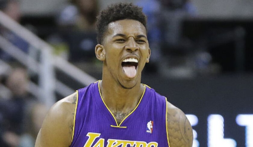 Nick Young reacts after hitting a three-pointer against Utah.