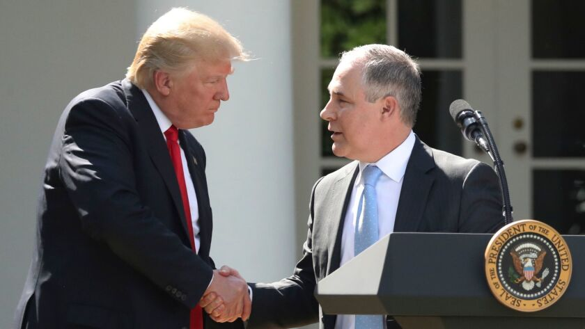 President Donald Trump shakes hands with EPA Administrator Scott Pruitt in the Rose Garden of the White House in Washington on June 1.