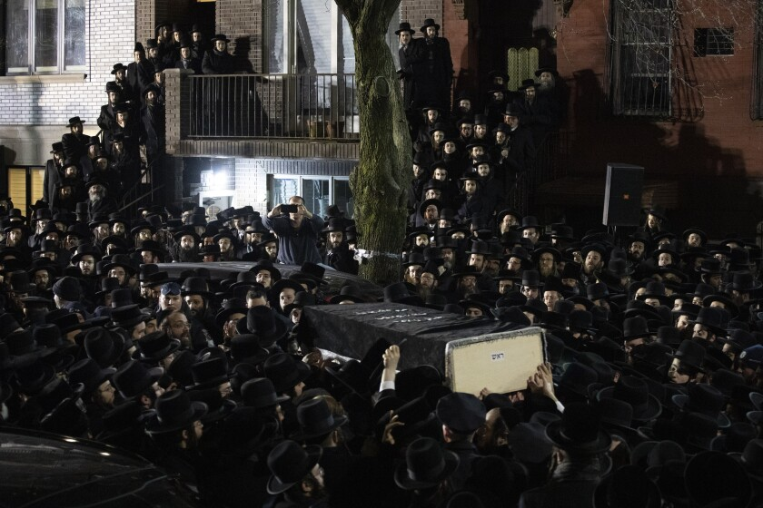 Orthodox Jews carry Moshe Deutsch's casket outside a Brooklyn synagogue following his funeral Wednesday. Deutsch was killed Tuesday in a shooting inside a Jersey City, N.J., kosher food market.
