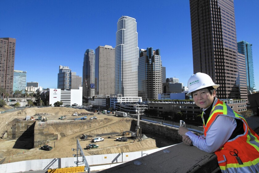 """I-Fei Chang, chief executive of Greenland USA, looks over the site of its $1-billion Metropolis Los Angeles hotel, condo and shopping complex last year. The company said she has resigned for """"personal reasons."""""""