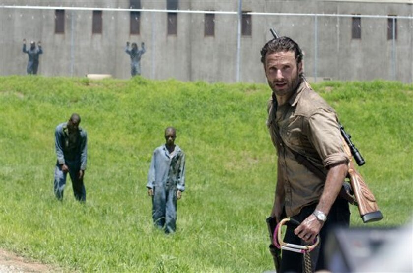 """This image released by AMC shows Andrew Lincoln as Sheriff Rick Grimes in a scene from the season three premiere episode of """"The Walking Dead,"""" premiering Sunday at 9p.m. EST on AMC. (AP Photo/AMC, Gene Page)"""