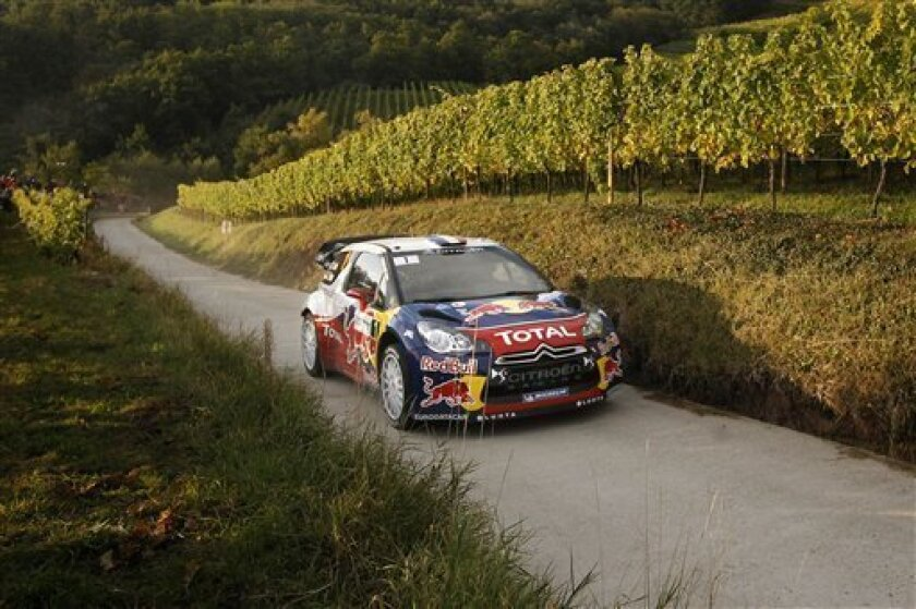 Citroen driver Sebastien Loeb, of France, and his co-driver Daniel Elena, of Monaco, steer their car during the 9th stage of the Rally de France, in Nothalten, eastern France, Saturday, Oct. 6, 2012. (AP Photo/Laurent Cipriani)