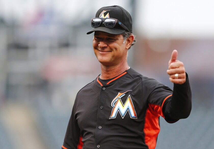 Marlins Manager Don Mattingly gives a thumbs-up to fans during batting practice before a game against the Colorado Rockies on Aug 5.
