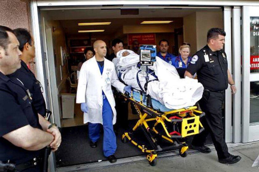 Bryan Stow, the Giants fan who was beaten at Dodger Stadium, is wheeled out of L.A. County-USC Medical Center.