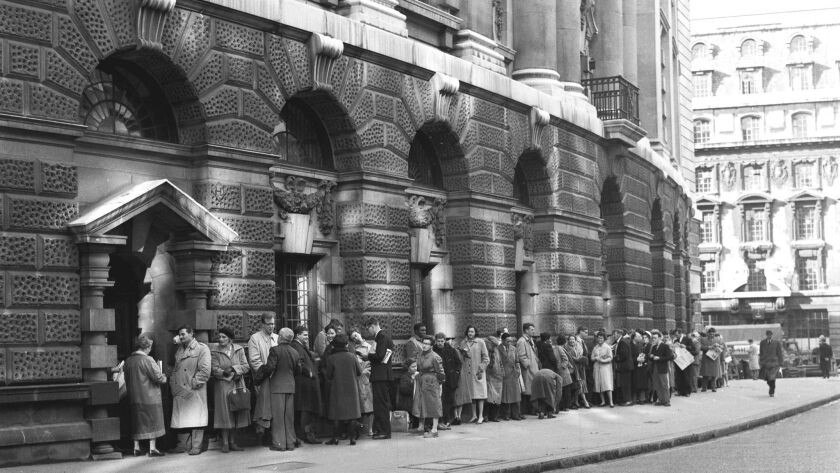 """Spectators line up outside the Old Bailey Central Criminal Court in London in 1960 to watch the """"Lady Chatterley's Lover"""" trial."""