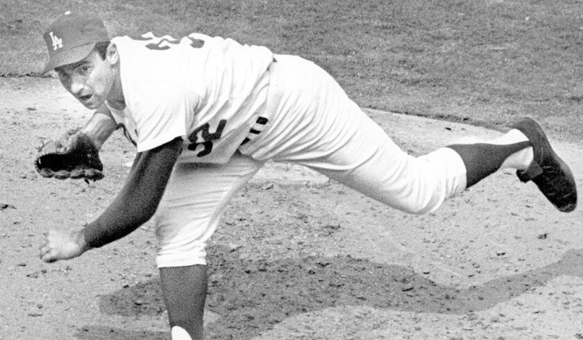 Sandy Koufax pitches in 1965, the year he started and won Game 7 of the World Series on two days' rest.